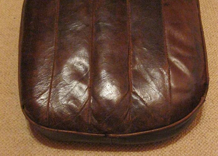 Repaired leather vintage car seat